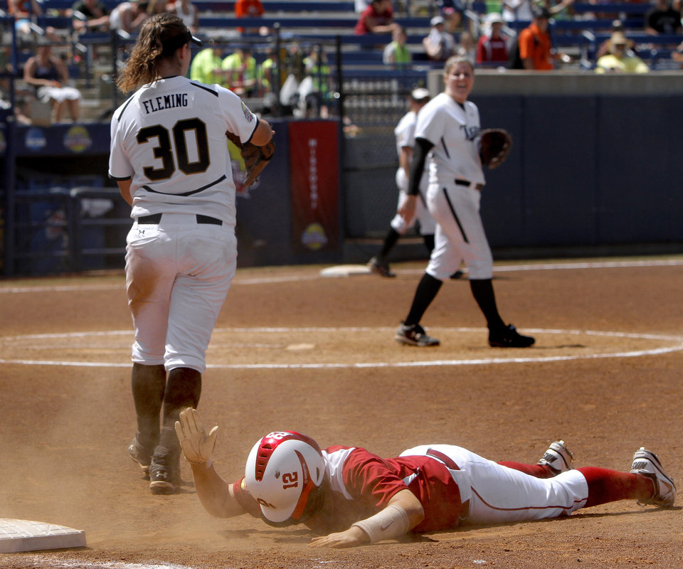 Oklahoma's Brittany Williams (23) reacts after getting called out at first base in the seventh inning of a Women's College World Series softball game between the University Oklahoma and Missouri at ASA Hall of Fame Stadium in Oklahoma City, Saturday, June 4, 2011. Missouri won, 4-1. Photo by Bryan Terry, The Oklahoman