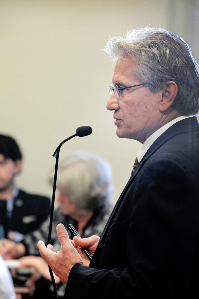 Photo - Attorney Chad Smith testifies during an OSSAA hearing at the State Capitol, Thursday, October 3, 2013. Smith is the former principal chief of the Cherokee Nation. Photo by David McDaniel, The Oklahoman