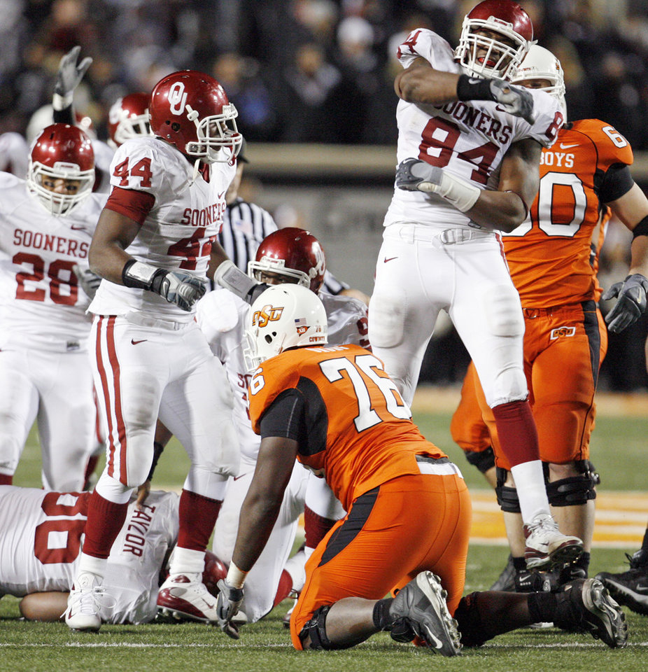 OU's Frank Alexander (84) celebrates a recovery by Adrian Taylor (86) of a Zac Robinson (not pictured) fumble in the fourth quarter of the college football game between the University of Oklahoma Sooners (OU) and Oklahoma State University Cowboys (OSU) at Boone Pickens Stadium on Saturday, Nov. 29, 2008, in Stillwater, Okla. OU won, 61-41. STAFF PHOTO BY NATE BILLINGS