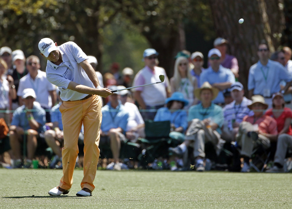 Photo - Bill Haas hits off the 15th fairway during the first round of the Masters golf tournament Thursday, April 10, 2014, in Augusta, Ga. (AP Photo/Matt Slocum)