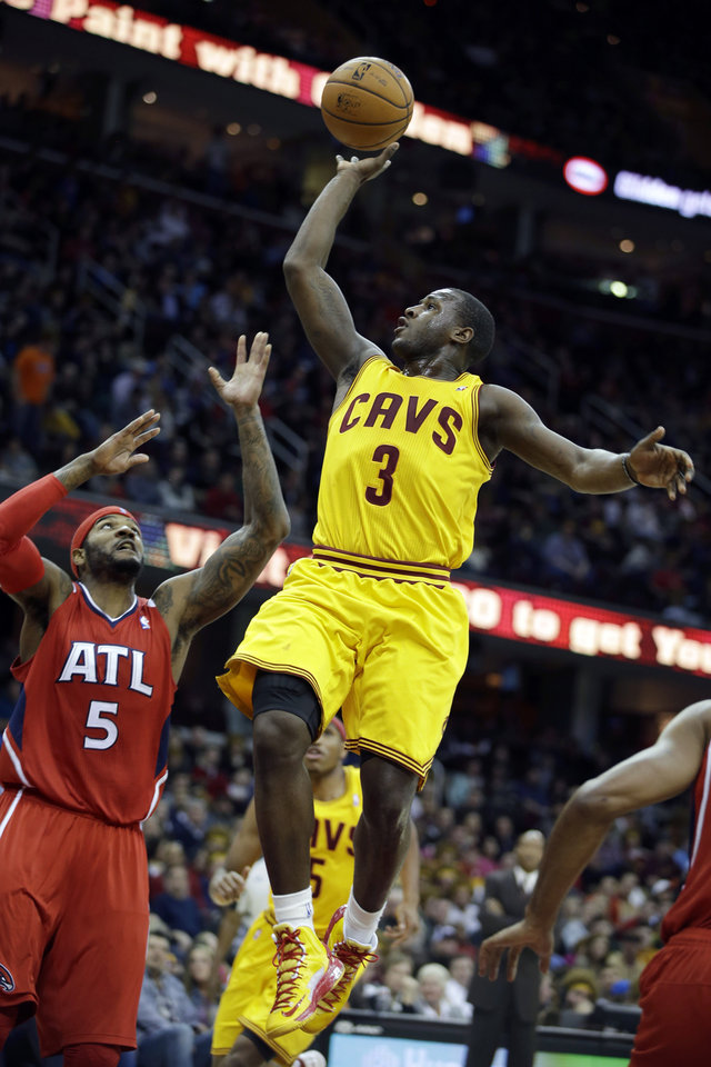 Cleveland Cavaliers' Dion Waiters (3) shoots over Atlanta Hawks' Josh Smith (5) in the second quarter of an NBA basketball game, Friday, Dec. 28, 2012, in Cleveland. (AP Photo/Mark Duncan)