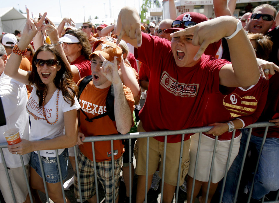 OU and Texas fans cheer before the first half of the Red River Rivalry college football game between the University of Oklahoma Sooners (OU) and the University of Texas Longhorns (UT) at the Cotton Bowl on Saturday, Oct. 2, 2010, in Dallas, Texas.   Photo by Bryan Terry, The Oklahoman