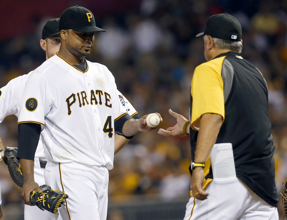 Photo - Pittsburgh Pirates starting pitcher Francisco Liriano gives the ball to manager Clint Hurdle after being lifted after giving up a single to Atlanta Braves' B.J. Upton that drove in a run in the fifth inning of the baseball game on Tuesday, Aug. 19, 2014, in Pittsburgh. (AP Photo/Keith Srakocic)