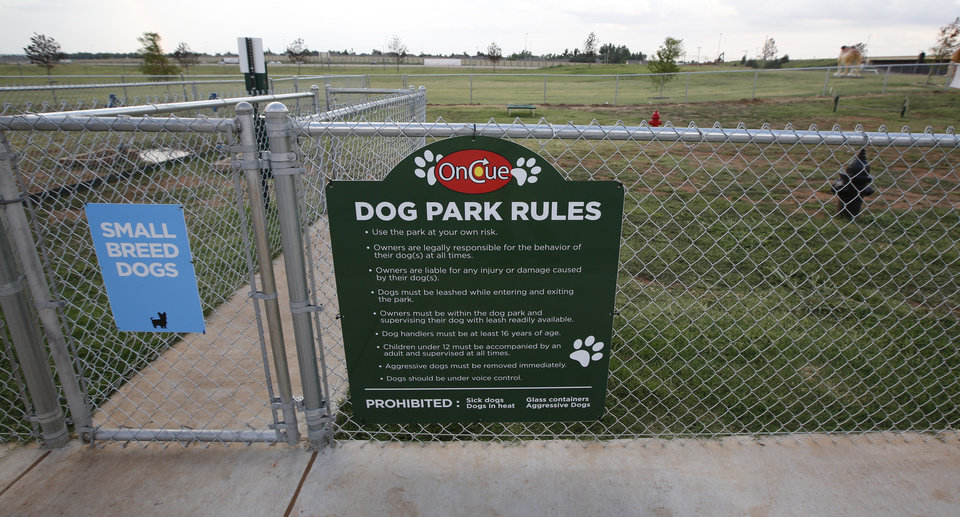 Photo -  The dog park at the OnCue store at Interstate 40 and Czech Hall Road in Yukon is designed to separate small and large dogs. [Photo By Steve Gooch, The Oklahoman]