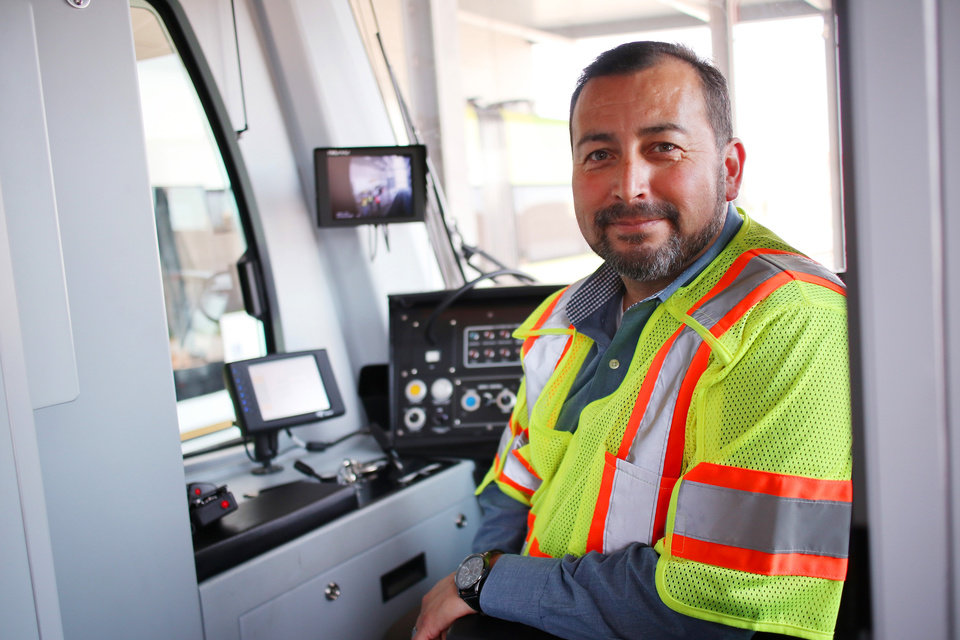 Photo -  Operations Manager Joel Garcia leads training for future streetcar drivers. In addition to learning to operate the streetcars, future engineers learn about the importance of customer service and being an ambassador for the city. [Photo by Doug Hoke, The Oklahoman]