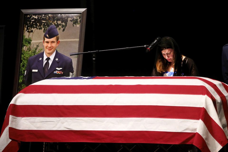 Photo - Fannin's widow, Sonya, shares an emotional tribute of love to her late husband. More than 1,700 people, many of whom were dressed in the US Air Force's  dark blue service dress uniform, filled the lower and upper levels of the Rose State College Performing Arts Center Monday morning, May, 13, 2013, to attend a memorial service for SSgt. Daniel N. Fannin, a brother in arms killed April 27 in a plane crash while on a mission in Afghanistan.  Fannin , 30, was assigned to the 552nd Operations Support Squadron at Tinker Air Force base. He joined the Air Force in 2001. Photo  by Jim Beckel, The Oklahoman.