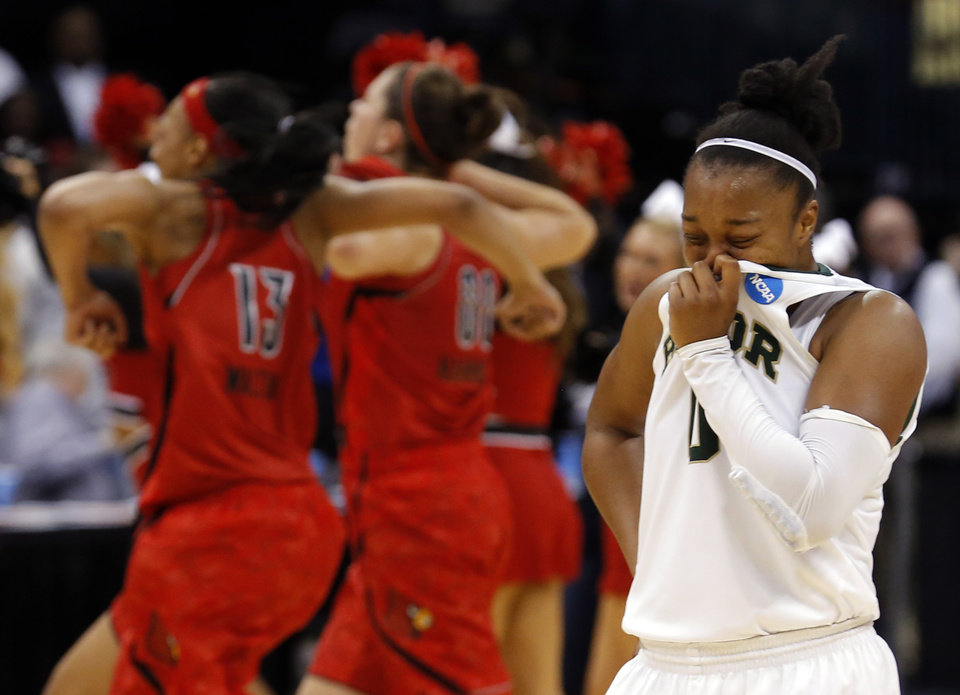 Baylor's Odyssey Sims (0) reacts as Louisville celebrates their win over the Lady Bears following the college basketball game between Baylor University and the Louisville at the Oklahoma City Regional for the NCAA women's college basketball tournament at Chesapeake Energy Arena in Oklahoma City, Sunday, March 31, 2013. Photo by Sarah Phipps, The Oklahoman