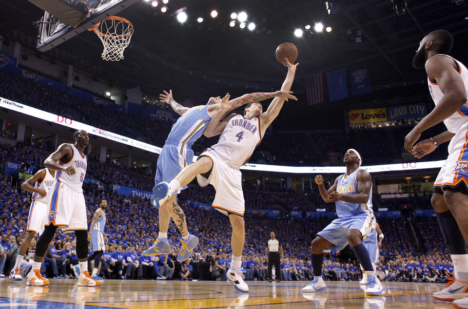 Denver\'s Chris Andersen (11) and Oklahoma City\'s Nick Collison (4) battle for a rebound during the first round NBA playoff game between the Oklahoma City Thunder and the Denver Nuggets on Sunday, April 17, 2011, in Oklahoma City, Okla. Photo by Chris Landsberger, The Oklahoman