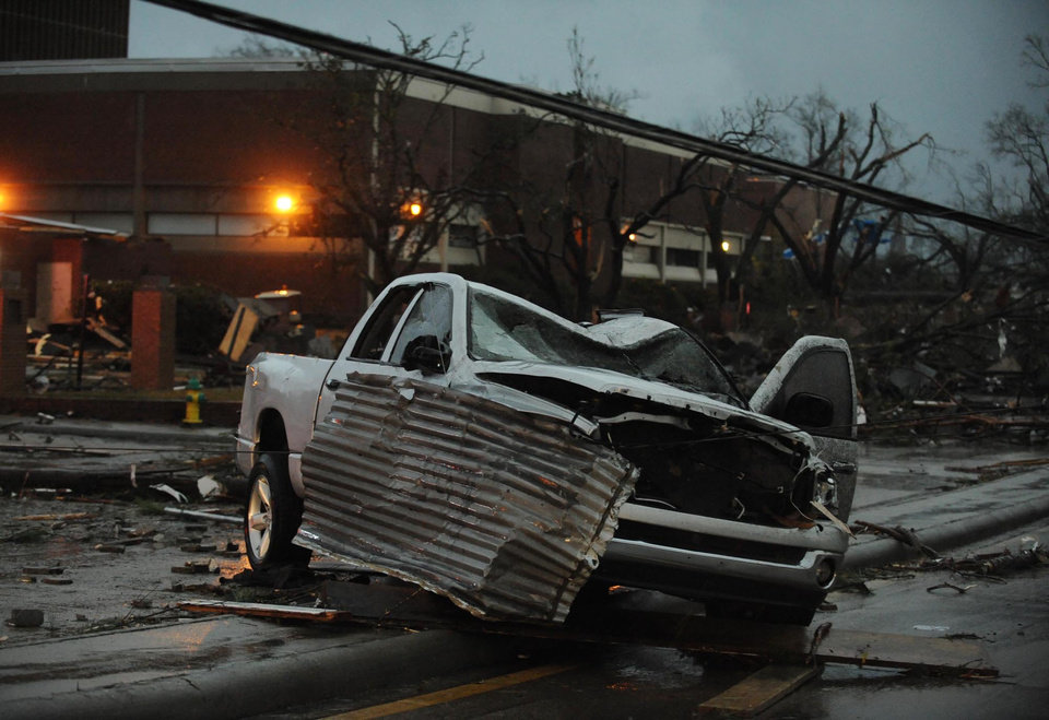 A heavily damaged vehicle sits near the front of the University of Southern Mississippi on Hardy Street in Hattiesburg Miss., Feb 10, 2013 after a tornado passed through the city Sunday afternoon. (AP Photo/Hattiesburg American, Ryan Moore) ORG XMIT: MSHAT103
