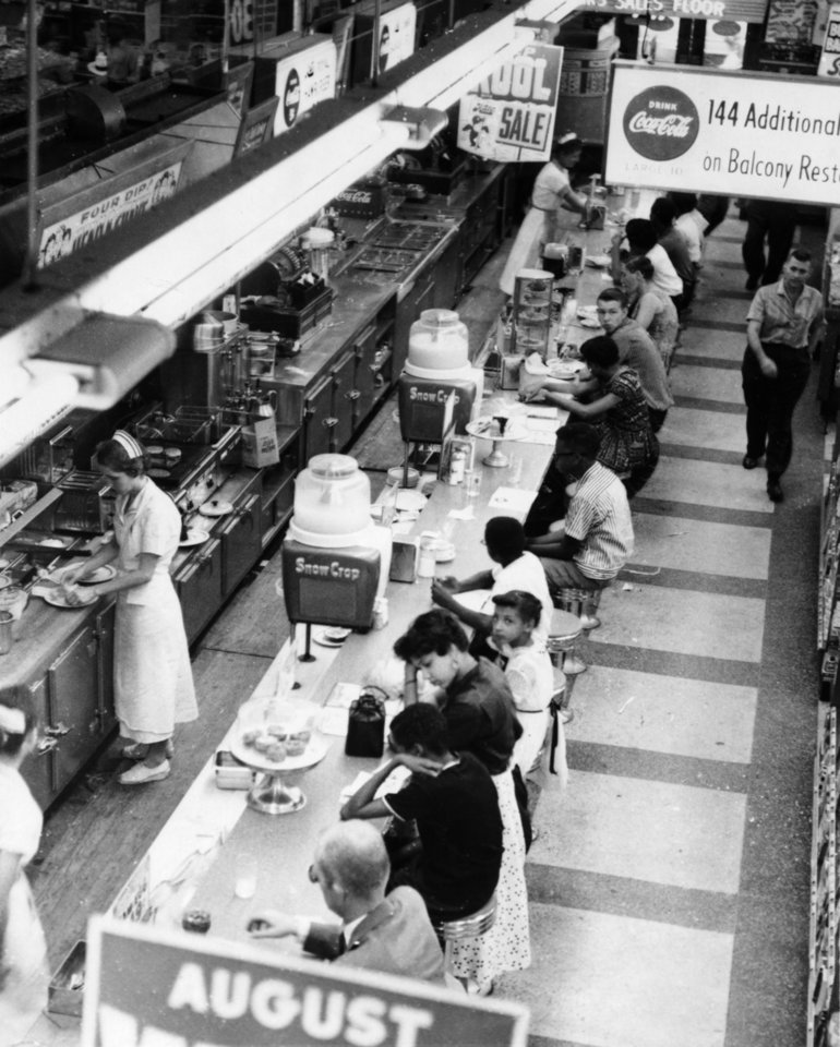 Photo - Black children sitting at the luncheon counter at Katz Drug Store, 200 W Main in downtown Oklahoma City, are refused service, even though white customers are served.      Black youths staged a