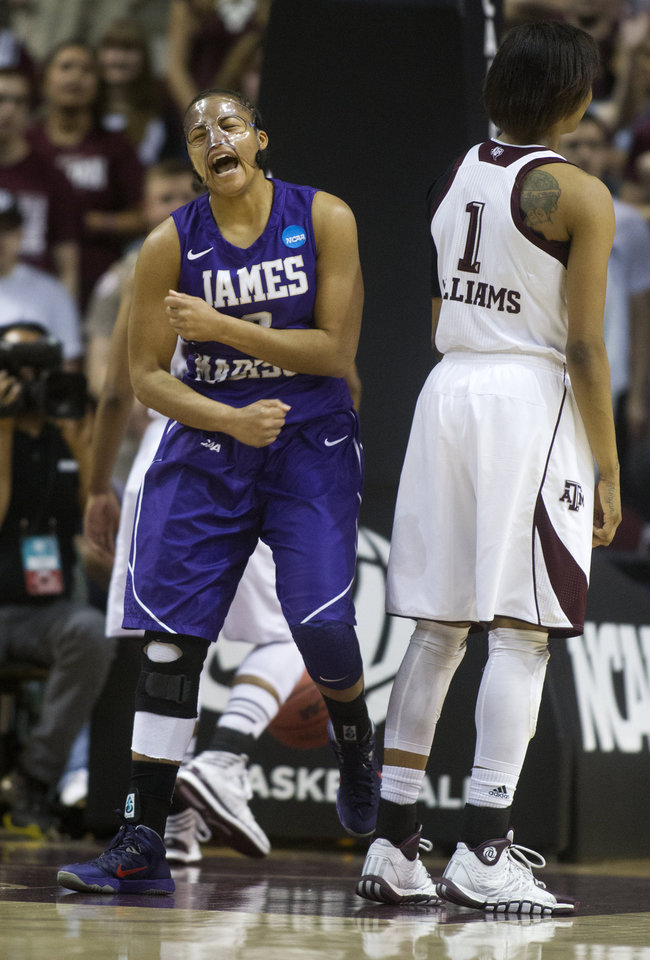 Photo - James Madison forward Toia Giggetts celebrates after scoring a basket during the first half of an NCAA women's basketball game against Texas A&M, Tuesday, March 25, 2014, in College Station, Texas. (AP Photo/Patric Schneider)