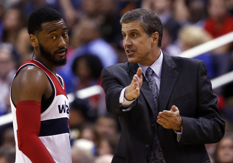 Photo - Washington Wizards guard John Wall listens to head coach Randy Wittman in the second half of an NBA basketball game against the Miami Heat, Monday, April 14, 2014, in Washington. The Wizards won 114-93. (AP Photo/Alex Brandon)