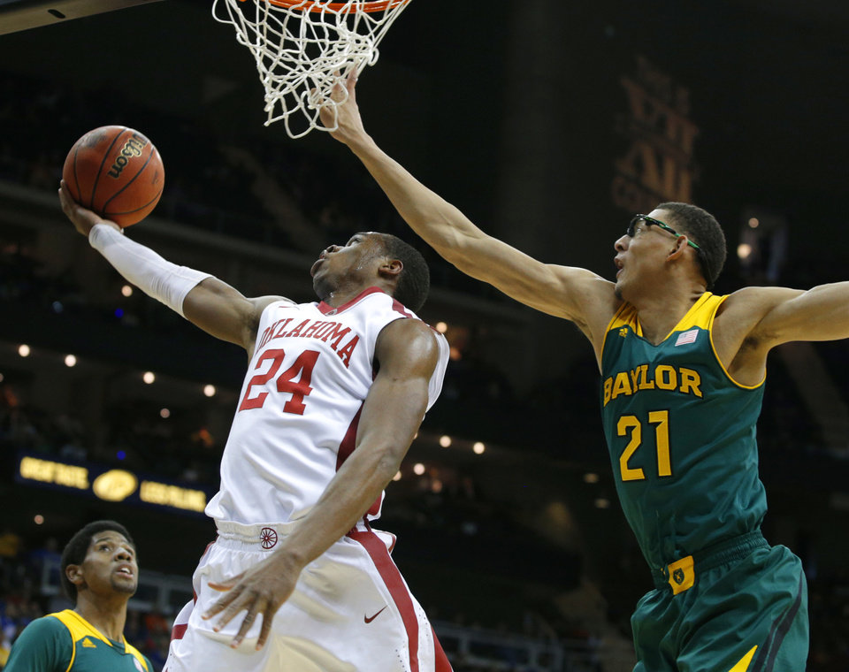 Photo - Oklahoma's Buddy Hield (24) goes to the basket past Baylor's Isaiah Austin (21) during the Big 12 Tournament college basketball game between the University of Oklahoma and Baylor at the Sprint Center in Kansas City, Mo., Thursday, March 13, 2014. Baylor won 78-73.  Photo by Bryan Terry, The Oklahoman