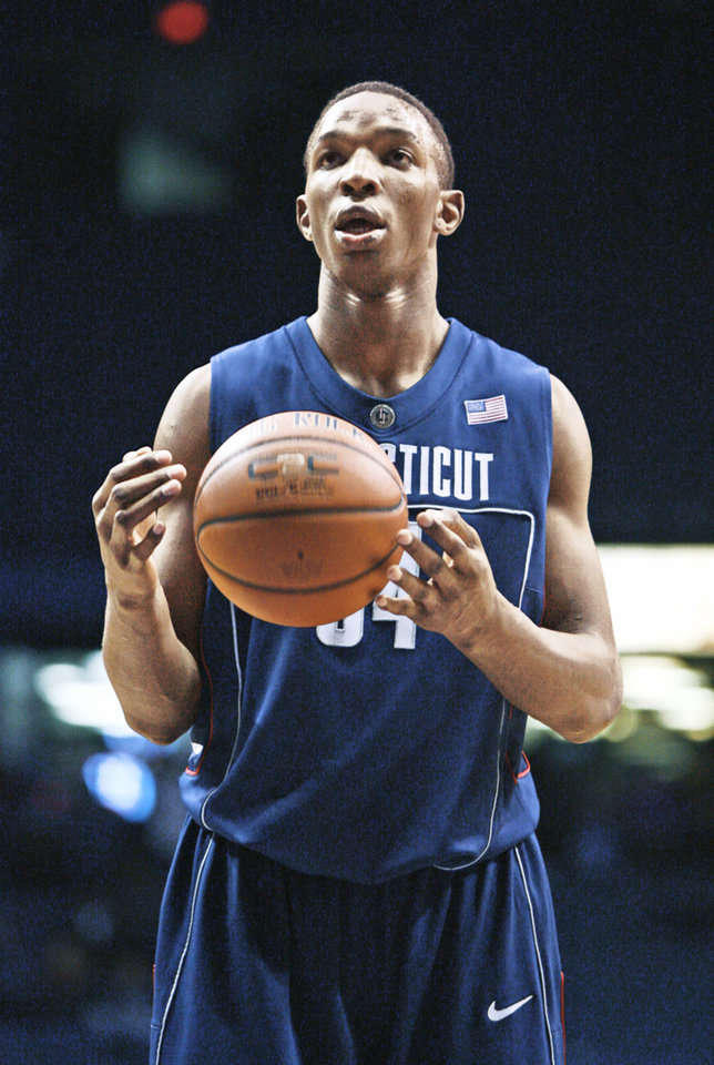 Photo - University of Connecticut's Hasheem Thabeet prepares to shoot a free throw during the second half of an NCAA college basketball game Wednesday, Jan. 28, 2009, in Chicago. (AP Photo/Jim Prisching) ORG XMIT: OTKJP114