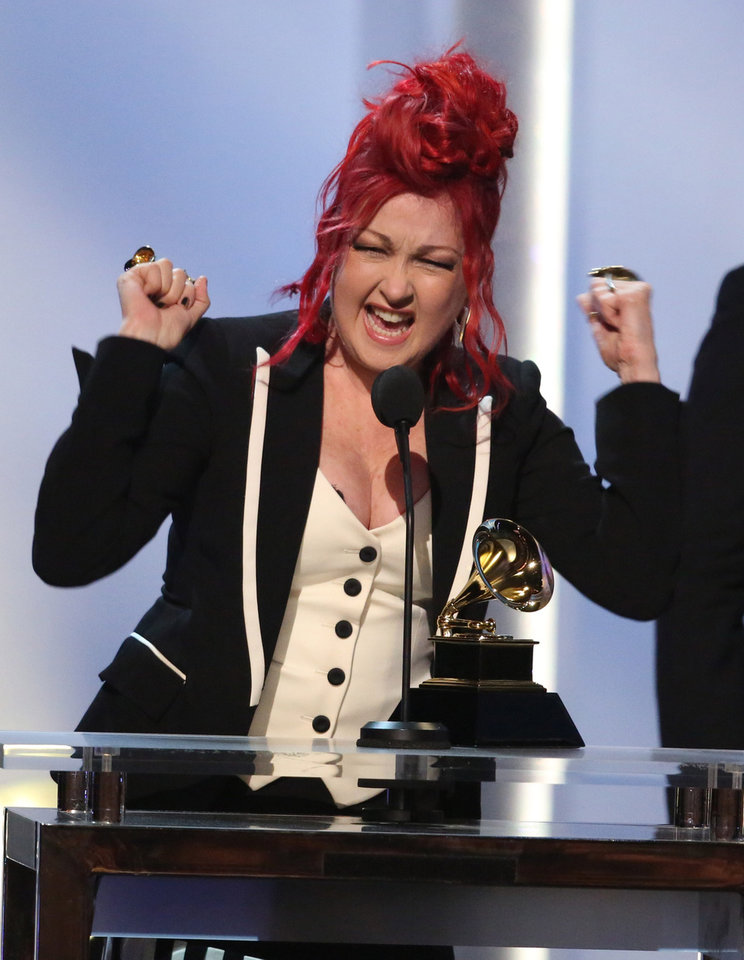 Photo - Cyndi Lauper accepts the best musical theater album award for