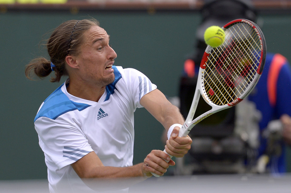 Photo - Alexandr Dolgopolov, of Ukraine, hits to Milos Raonic, of Canada, during a quarterfinal match at the BNP Paribas Open tennis tournament on Thursday, March 13, 2014, in Indian Wells, Calif. (AP Photo/Mark J. Terrill)