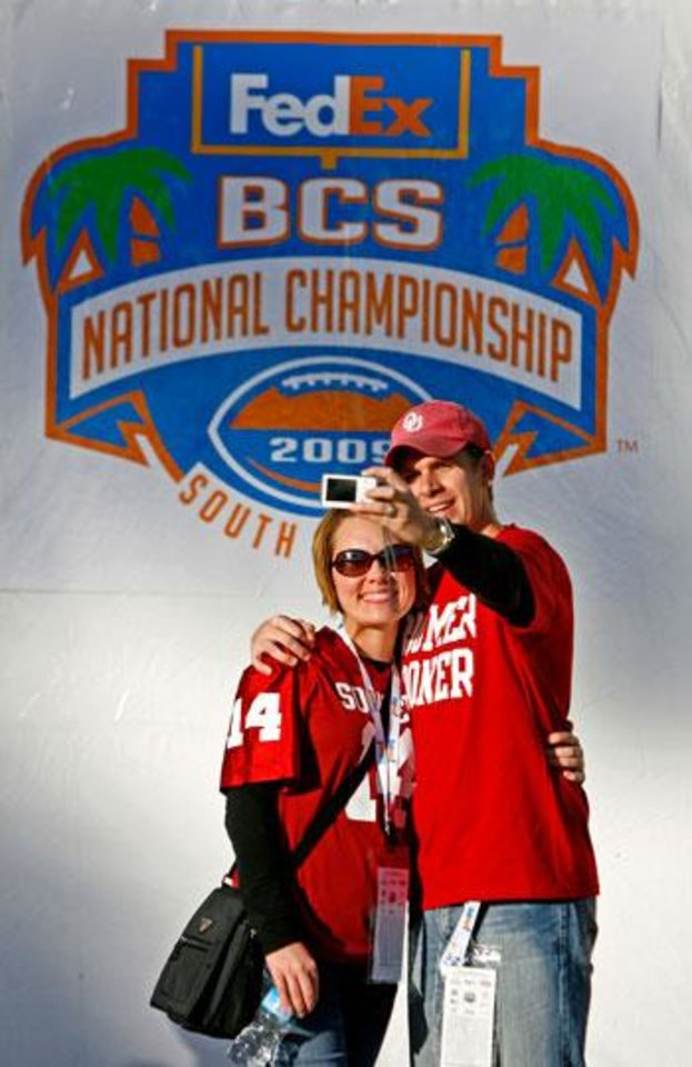 Photo -  Dylan and Rachel Cole of Moore, Okla., take their photo outside Dolphin Stadium before the BCS National Championship college football game between the University of Oklahoma Sooners (OU) and the University of Florida Gators (UF) on Thursday, Jan. 8, 2009, at Dolphin Stadium in Miami Gardens, Fla.   PHOTO BY BRYAN TERRY, THE OKLAHOMAN
