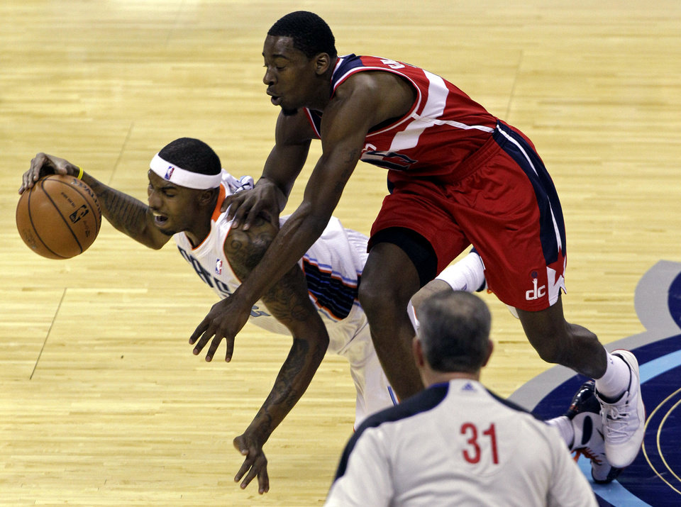 Charlotte Bobcats' Tyrus Thomas, left, is fouled by Washington Wizards' Jordan Crawford during the first half of an NBA basketball game in Charlotte, N.C., Tuesday, Nov. 13, 2012. (AP Photo/Chuck Burton)