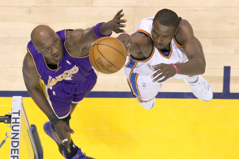 Photo - Oklahoma City Thunder forward Serge Ibaka shoots as L.A.'s Lamar Odom defends during a game in April. PHOTO BY HUGH SCOTT, THE OKLAHOMAN