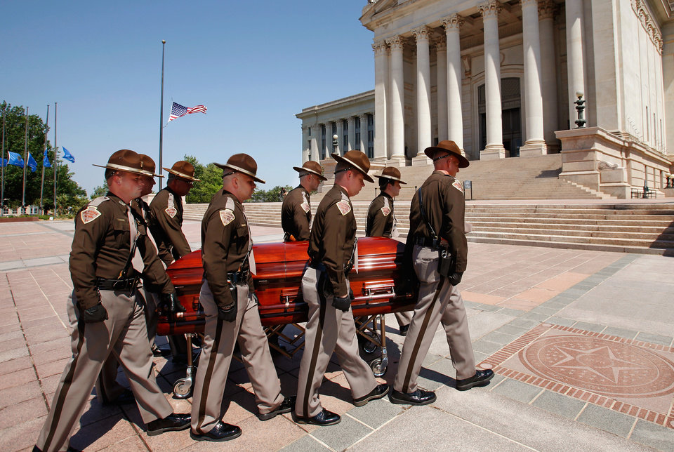 State Troopers escort the casket with Clara Luper's body across the south plaza at the Capitol after it arrived in a  hearse. Troopers remained with the casket while it was displayed for public viewing on the first floor, Oklahoma civil rights leader  Clara Luper was honored by the state as her body lay in repose on the first floor of the State Capitol, Thursday, June 16, 2011. Her dark wood casket remained closed as a pair of Oklahoma Highway Patrol troopers stood silently on either side of the casket. Luper died in Oklahoma City last week. Photo by Jim Beckel, The Oklahoman