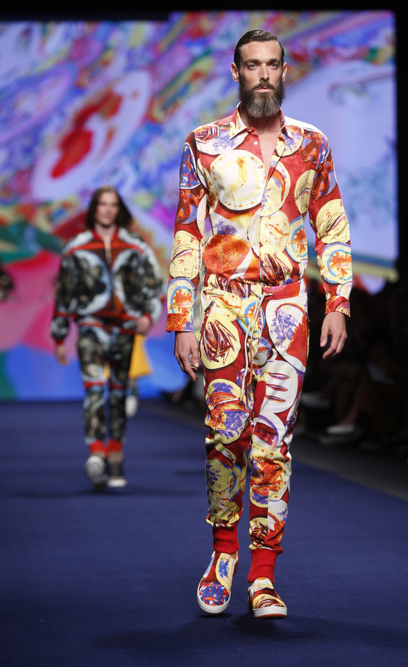 Photo - Models wear creations for Etro men's Spring-Summer 2015 collection, part of the Milan Fashion Week, unveiled in Milan, Italy, Monday, June 23, 2014. (AP Photo/Luca Bruno)