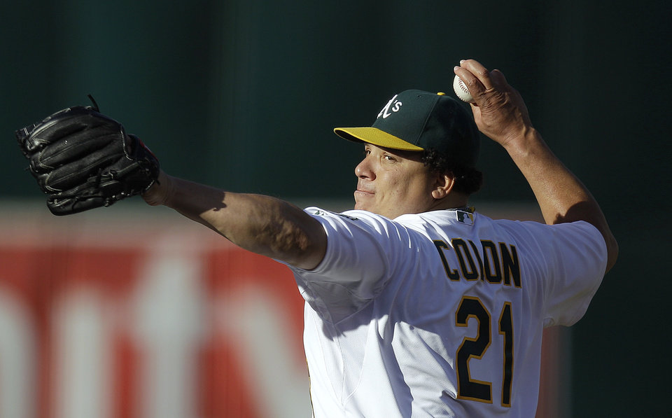 Oakland Athletics' Bartolo Colon works against the Cleveland Indians in the first inning of a baseball game Saturday, Aug. 18, 2012, in Oakland, Calif. (AP Photo/Ben Margot)