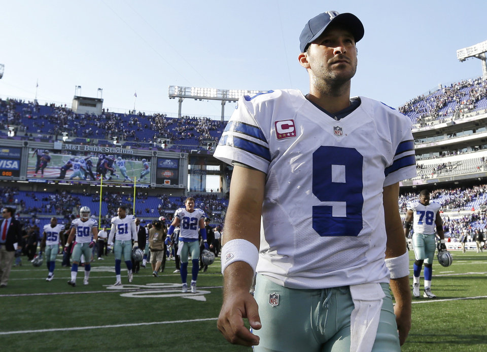 Photo -   Dallas Cowboys quarterback Tony Romo walks off the field after an NFL football game against the Baltimore Ravens in Baltimore, Sunday, Oct. 14, 2012. Baltimore won 31-29. (AP Photo/Patrick Semansky)