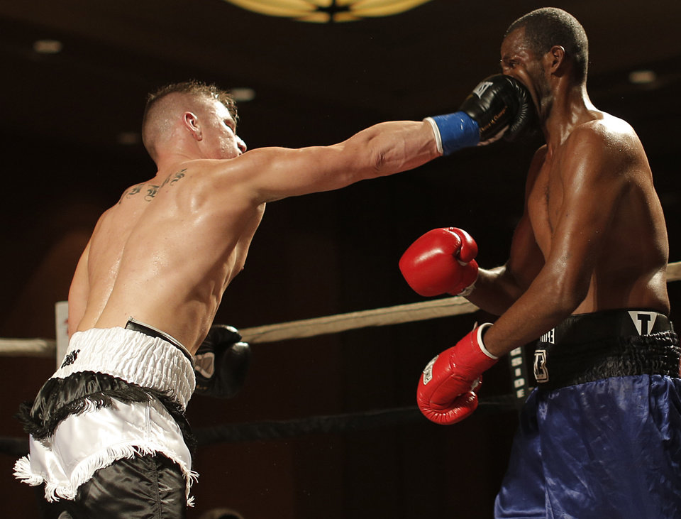 Bo Gibbs Jr. (left), of Oklahoma City, fights Lyle Barron, of Oklahoma City, at the Cox Convention Center in Oklahoma City, Thursday, Sept. 20, 2012. Photo by Garett Fisbeck, The Oklahoman