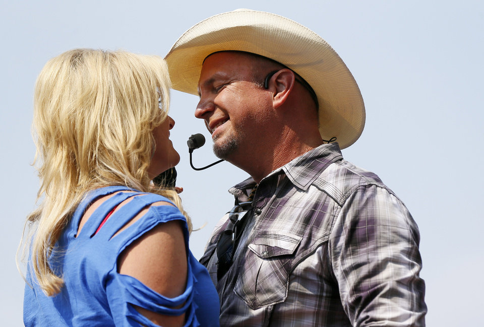 Trisha Yearwood and Garth Brooks perform during the Oklahoma Twister Relief Concert, benefiting victims of the May tornadoes, at Gaylord Family - Oklahoma Memorial Stadium on the campus of the University of Oklahoma in Norman, Okla., Saturday, July 6, 2013. Photo by Nate Billings, The Oklahoman