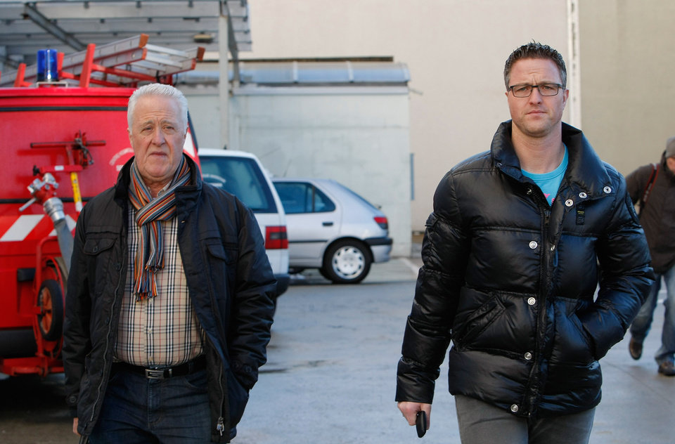 Photo - Michael Schumacher's father Rolf, left, and brother Ralf arrive at Grenoble Hospital, French Alps, Sunday Jan. 5, 2014, where former seven-time Formula One champion Michael Schumacher is being treated after sustaining a head injury during a ski accident. Schumacher has been in a medically induced coma since Sunday, Dec. 29, 2013, when he struck his head on a rock while on a family vacation. (AP Photo/Claude Paris)