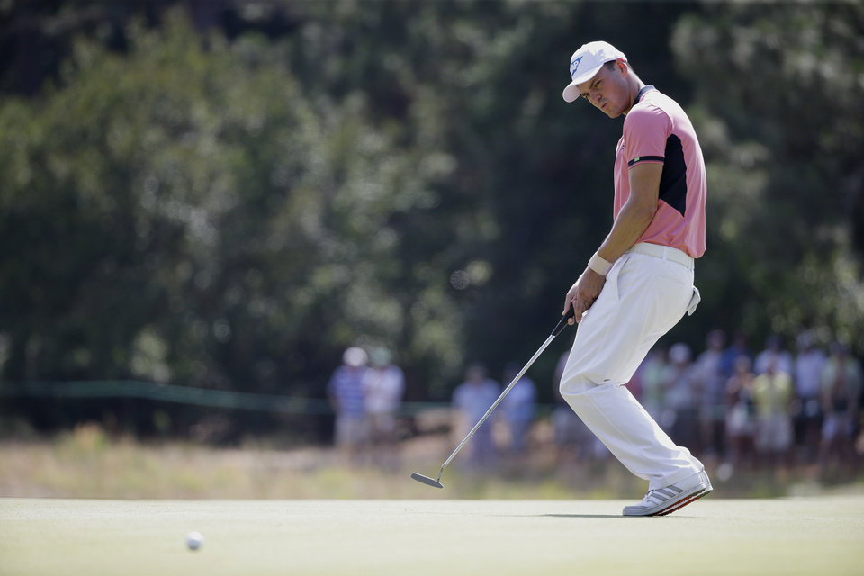 Photo - Martin Kaymer, of Germany, reacts after missing a putt on the second hole during the third round of the U.S. Open golf tournament in Pinehurst, N.C., Saturday, June 14, 2014. (AP Photo/David Goldman)