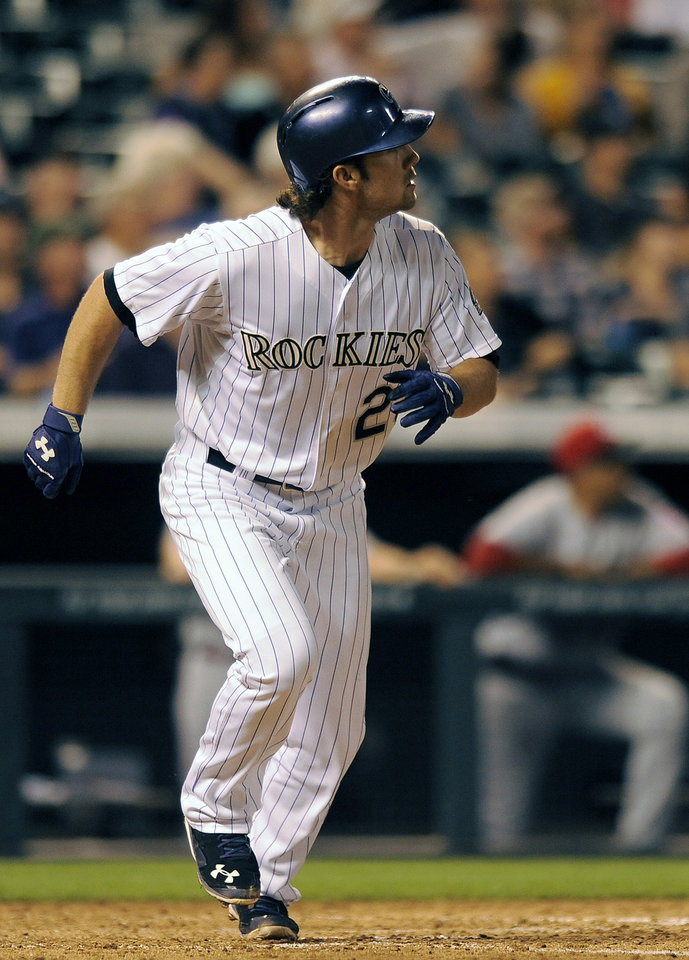 Photo - Colorado Rockies Charlie Culberson watches his three-run home run sail over the wall in the fifth inning of a baseball game against the Cincinnati Reds on Thursday, Aug. 14, 2014, in Denver. (AP Photo/Chris Schneider)