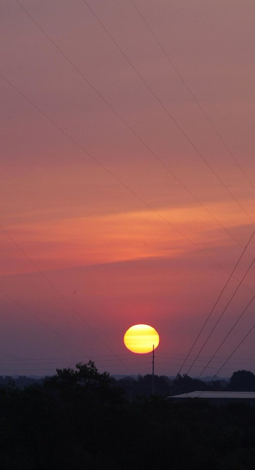 Sunrise in northeast Oklahoma City Thursday, Aug. 22, 2013. Photo by Paul B. Southerland, The Oklahoman