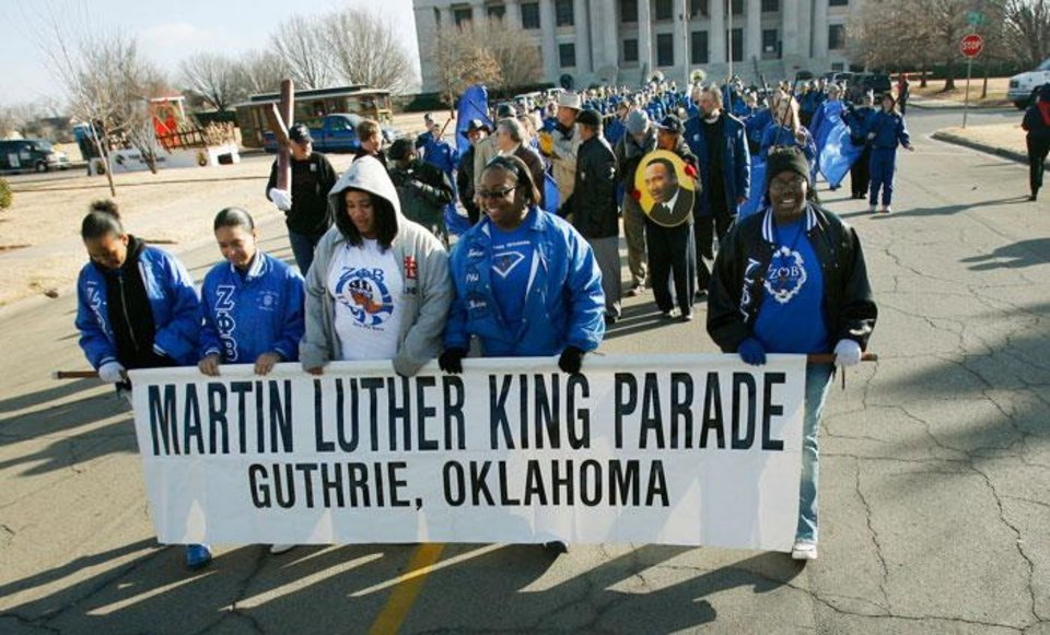 Members of Zeta Phi Beta hold a banner as they walk in the Martin Luther King Jr. Day parade in Guthrie, Okla., Monday, Jan. 19, 2009. BY PAUL HELLSTERN, THE OKLAHOMAN