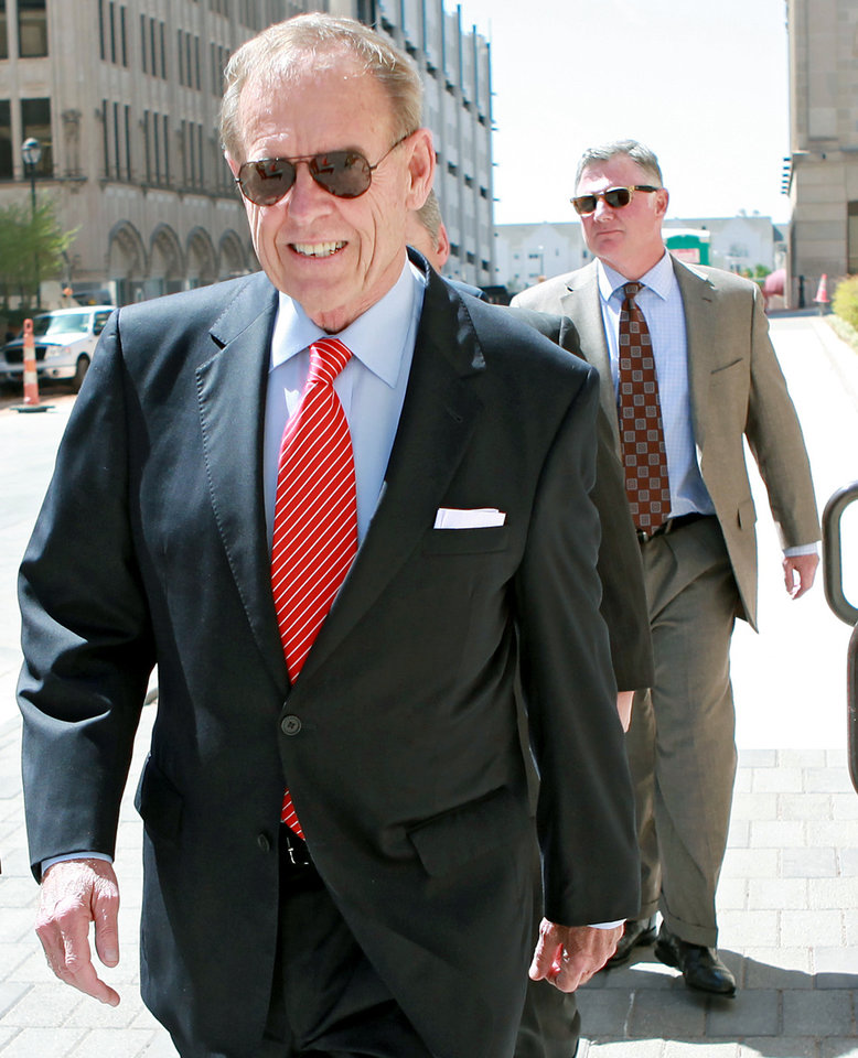 Photo - NOT GUILTY PLEA: Attorney Martin Stringer (foreground) and lobbyist Andrew Skeith (background) walk toward the Federal Courthouse in Oklahoma City on Wednesday, April 6, 2011. Former Senate leader Mike Morgan, lobbyist Andrew Skeith and attorney Martin Stringer pleaded not guilty at a 13-minute arraignment today in a public corruption case. Photo by John Clanton, The Oklahoman ORG XMIT: KOD