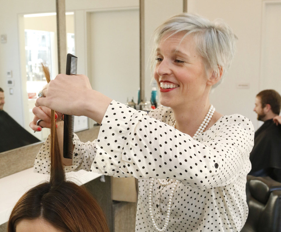 Photo - Sarah Payne, a stylist at The Barber Salon in Oklahoma City, is among the Oklahomans who have selected a plan through the federal health insurance marketplace.  Photo by Paul Hellstern, The Oklahoman  PAUL HELLSTERN -