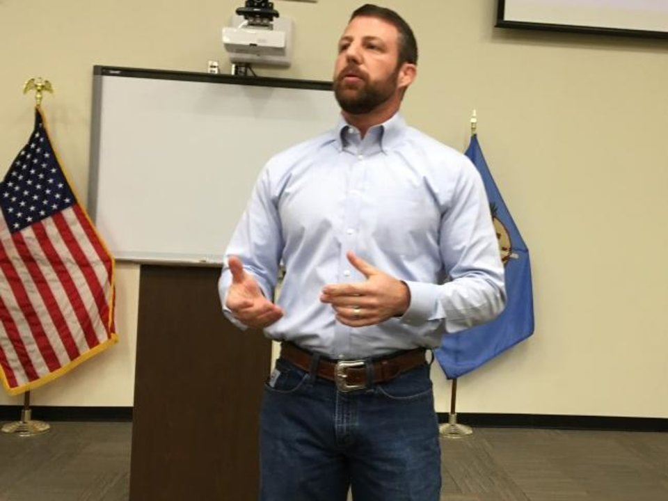 Photo -  U.S. Rep. Markwayne Mullin speaks during a town hall meeting on Tuesday in Muskogee.   [Chris Casteel/The Oklahoman]