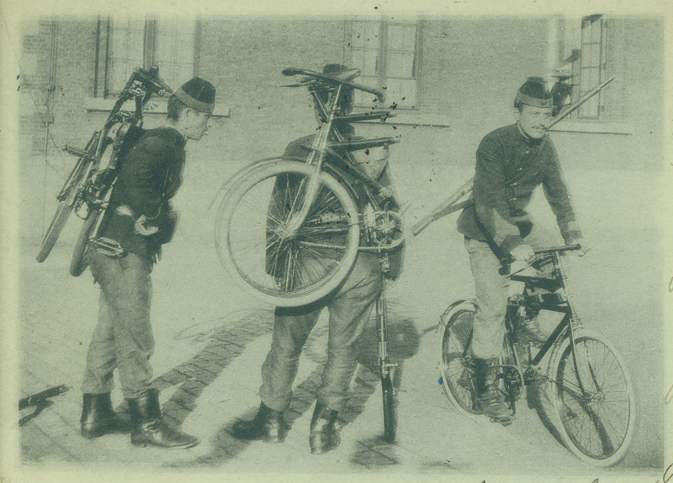 Photo - In this photo of an undated postcard provided by the WielerMuseum Roeselare, Belgian World War I soldiers with their foldable bicycles in Belgium during wartime. Late in the 19th century the Belgian Army took an interest in the newly emerging sport of cycling. A separate unit was created and came to be known as the Cyclist Riflemen. During World War I they played a key role in the Battle of Haelen in Belgium. The German Army nicknamed them the Black Devils, owing to their black outfits and hats, as well as their fast silent movements. (AP Photo/WielerMuseum)