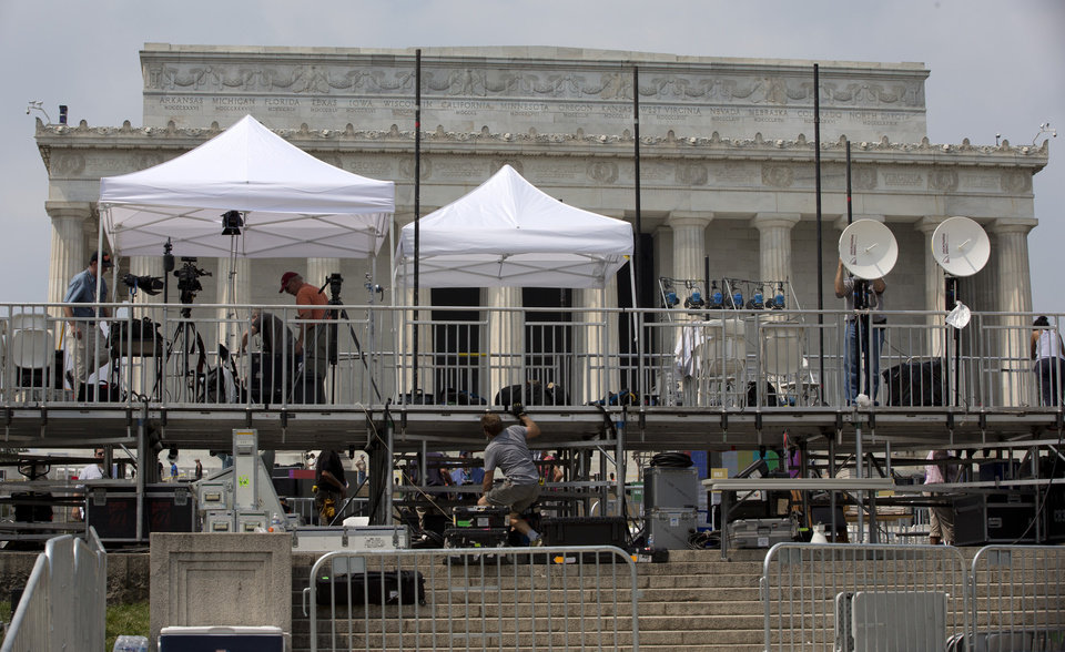 Members of the media set up equipment in front of the Lincoln Memorial in Washington, Tuesday, Aug. 27, 2013, for the 50th anniversary of the March On Washington celebrations that will be held Wednesday, Aug, 28, 2013.  Barack Obama, who will speak, was 2 years old and growing up in Hawaii when Martin Luther King Jr. delivered his �I Have a Dream� speech from the steps of the Lincoln Memorial. Fifty years later, the nation�s first black president will stand as the most high-profile example of the racial progress King espoused, delivering remarks at a nationwide commemoration of the 1963 demonstration for jobs, economic justice and racial equality.   (AP Photo/Carolyn Kaster)
