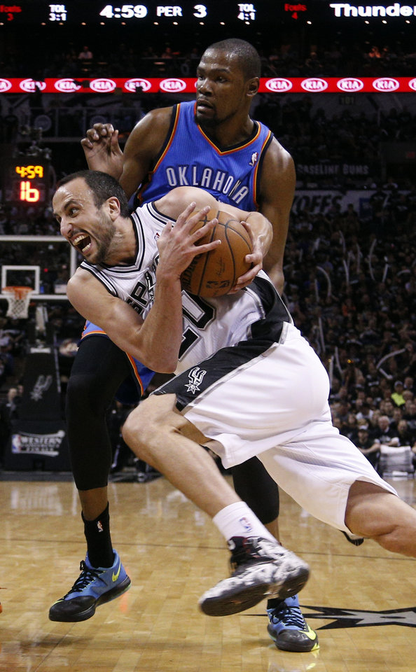 Photo - San Antonio's Manu Ginobili (20) drives past Oklahoma City's Kevin Durant (35) during Game 1 of the Western Conference Finals in the NBA playoffs between the Oklahoma City Thunder and the San Antonio Spurs at the AT&T Center in San Antonio, Monday, May 19, 2014. Photo by Sarah Phipps, The Oklahoman