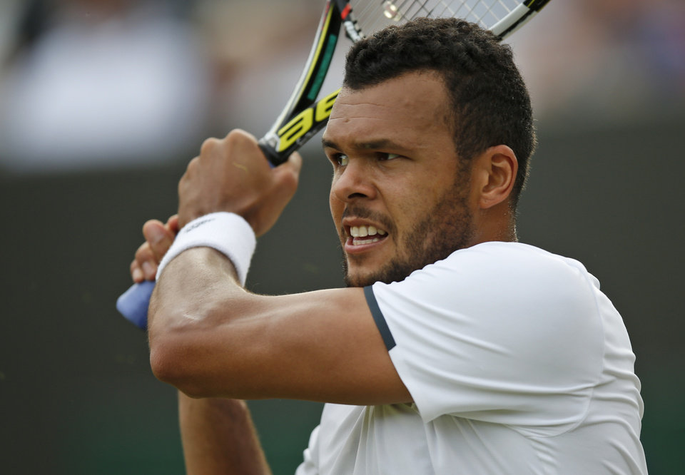 Photo - Jo-Wilfried Tsonga of France watches a return to Sam Querrey of the U.S. during their men's singles match at the All England Lawn Tennis Championships in Wimbledon, London, Wednesday, June 25, 2014. (AP Photo/Pavel Golovkin)