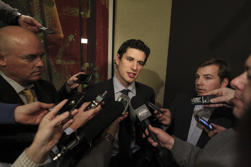 Pittsburgh Penguins' Sidney Crosby speaks to reporters, Thursday, Dec. 6, 2012 in New York. Talks in the NHL labor fight broke down after just one hour Thursday night, and it isn't known when the league and the players' association would get back together. (AP Photo/Mary Altaffer)