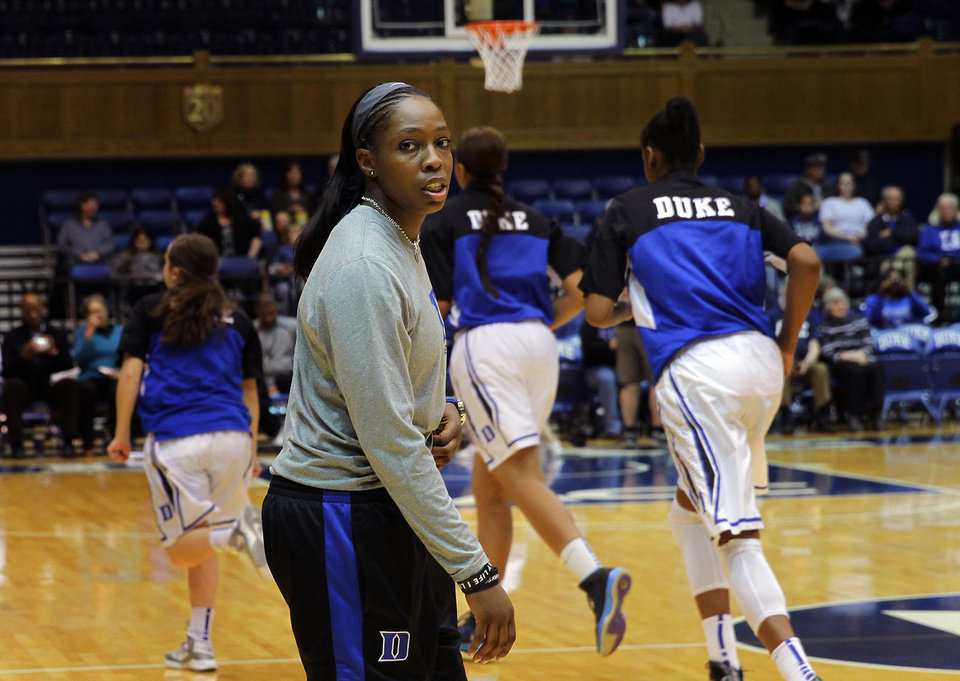 Photo - Duke senior Chelsea Gray watches the end of warm-ups as Duke prepares to play Virginia in an NCAA women's college basketball game, Thursday, Jan. 16, 2014, in Durham, N.C.  who earned All-America honors as a sophomore, will miss the remainder of the season due to a knee injury suffered in a recent game against Boston College. Duke won 90-55. (AP Photo/Ted Richardson)