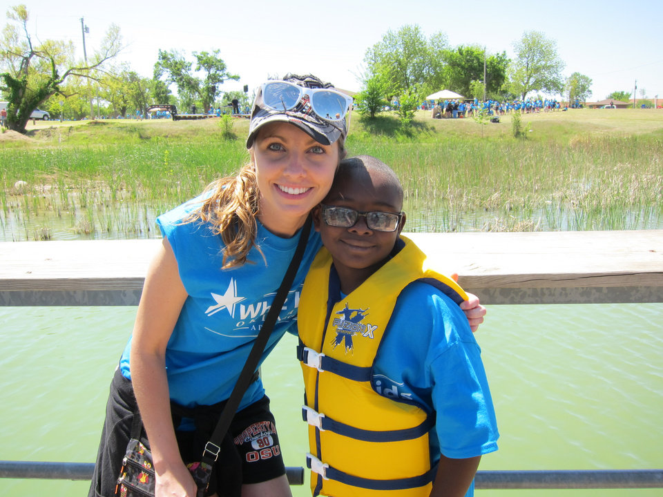 "Photo -  Megan Kilmer, a Traub Elementary School teacher, poses for a picture with Reece Jackson, 9, at the recent Whiz Kids ""Spring Fling"" celebration at Crystal Lake. Photo by Carla Hinton, The Oklahoman"