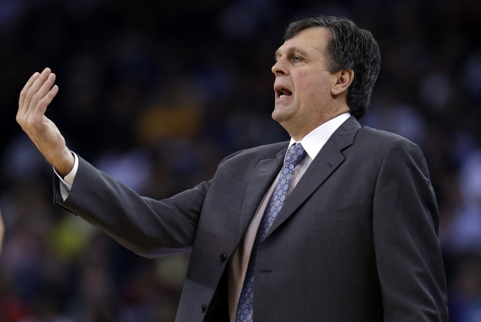 Photo - Houston Rockets coach Kevin McHale talks to his players during the first half of an NBA basketball game against the Golden State Warriors in Oakland, Calif., Tuesday, Feb. 12, 2013. (AP Photo/Marcio Jose Sanchez)