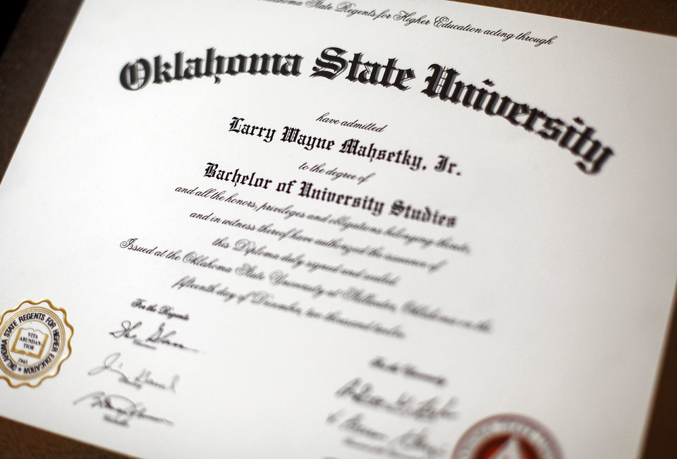 Photo - The diploma of Larry Mahsetky, 41 of Oklahoma City, who was a football player at Oklahoma State in the 1990s. His recent graduation helped Oklahoma State overcome NCAA penalties for graduation rates in their athletic department. Photo by KT King, The Oklahoman