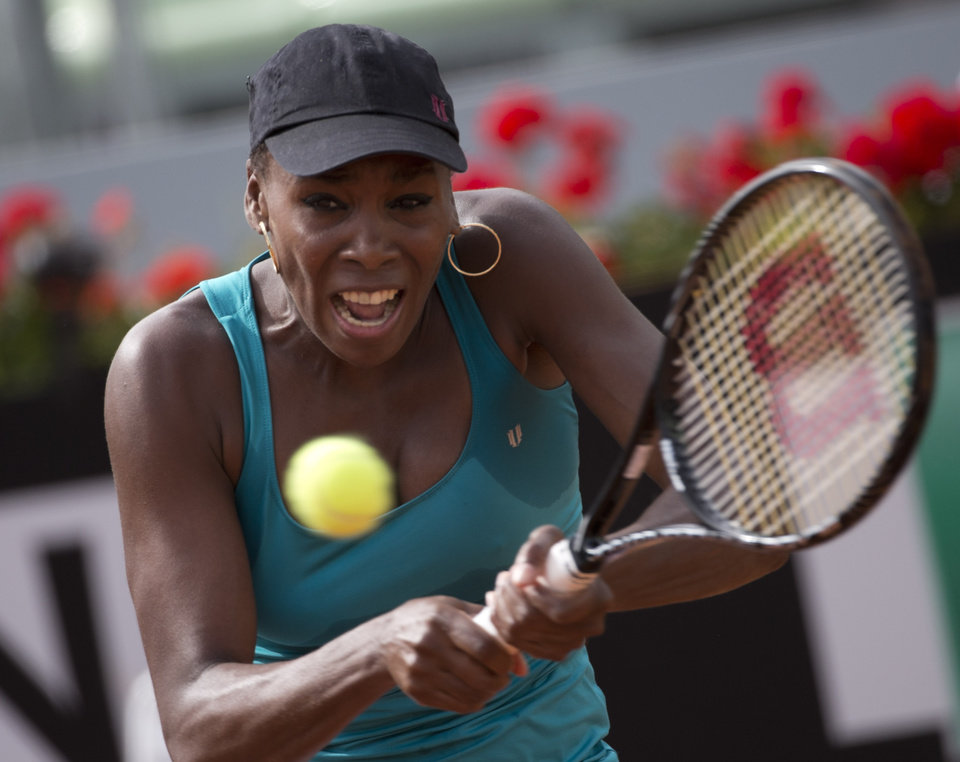 Photo - Venus Williams of the United States returns the ball to Annika Beck of Germany at the Italian Open tennis tournament, in Rome, Monday, May 12, 2014. (AP Photo/Alessandra Tarantino)