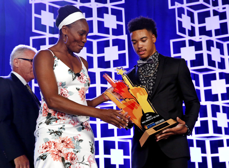 Photo -  Tennis icon Venus Williams presents the male athlete of the year award to Jason Taylor II of Carl Albert High School during The Oklahoman's All-City Prep Sports Awards at the Cox Convention Center on Tuesday. [Photo by Steve Sisney, The Oklahoman]
