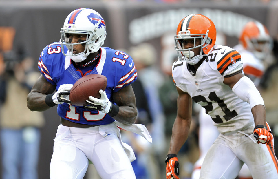 Photo -   Buffalo Bills wide receiver Steve Johnson (13) catches a 9-yard touchdown pass in front of Cleveland Browns cornerback Dimitri Patterson (21) in the fourth quarter of an NFL football game on Sunday, Sept. 23, 2012, in Cleveland. (AP Photo/David Richard)
