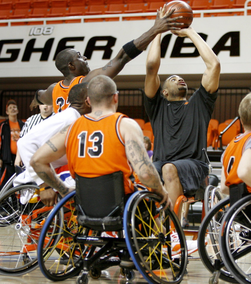 The Spokes' Jason Walley blocks the shot of OSU's Marshall Moses during a wheelchair basketball charity game at Gallager-Iba Arena in Stillwater, Okla., Tuesday, April 14, 2009. Photo by Bryan Terry, The Oklahoman